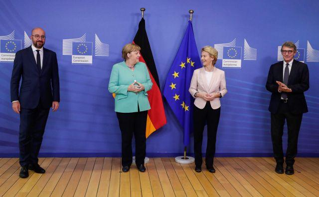 Udeleženci mini vrha (predsednik evropskega sveta Charles Michel, nemška kanclerka Angela Merkel, predsednica evropske komisije Ursula von der Leyen in predsednik evropskega parlamenta David Sassoli) so poudarili, da je ključna sklenitev sporazuma o ambicioznem svežnju za okrevanje že na vrhu EU prihodnji teden. Foto Stephanie Lecocq/Afp