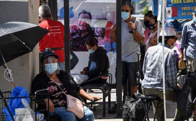 Prizor iz latinske četrti v Los Angelesu. FOTO: Robyn Beck/AFP
