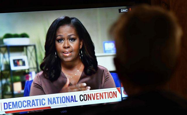 Michelle Obama je v govoru pozvala ljudi, naj na prihodnjih ameriških predsedniških volitvah volijo, kot da jim gre za življenje. FOTO: Chris Delmas/AFP