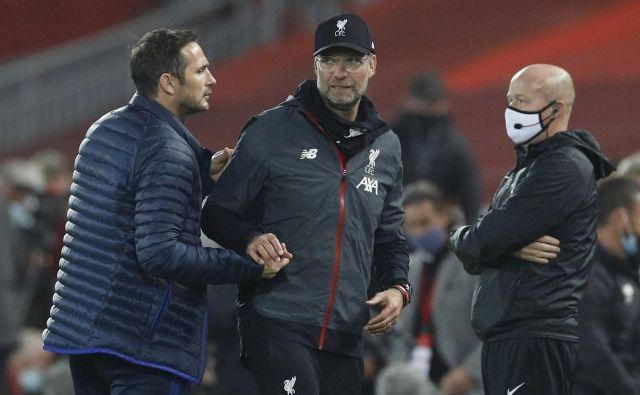 Frank Lampard in Jürgen Klopp sta si po zadnji tekmi segla v roke, a med njima ostaja nekaj nerazčiščenih računov. FOTO: Phil Noble/Reuters