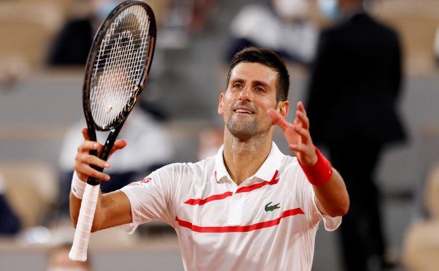 Srbski teniški igralec Novak Đoković je uspešno prestal prvo nalogo na poti do drugega naslova na odprtem prvenstvu Francije. FOTO: Gonzalo Fuentes/Reuters