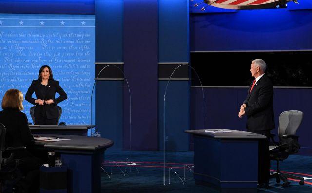 Republikanec Mike Pence in demokratka Kamala Harris med podpredsedniško debato. FOTO: Robyn Beck/AFP